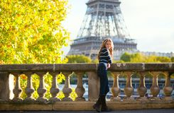 Beautiful girl in Paris on a fall day Stock Photos