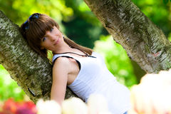 Beautiful girl in a park Royalty Free Stock Image