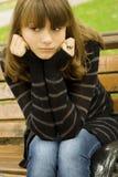 Beautiful girl in a park Stock Photos