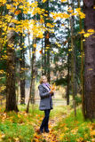 Beautiful Girl in Park. Beautiful smiling blond girl in autumn park Royalty Free Stock Photo
