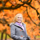 Beautiful Girl in Park. Beautiful smiling blond girl in autumn park Royalty Free Stock Image