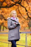 Beautiful Girl in Park. Beautiful smiling blond girl in autumn park Stock Photo
