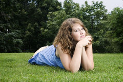 Beautiful girl in park. Beautiful girl laying down in park Royalty Free Stock Image