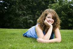 Beautiful girl in park. Beautiful girl laying down in park Stock Photo