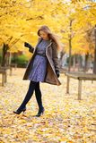 Beautiful girl in park on a fall day Royalty Free Stock Photo