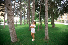 Beautiful girl in the park. Green grass and sunny weather Royalty Free Stock Photos