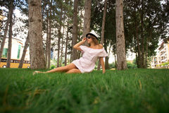 Beautiful girl in the park. Green grass and sunny weather Stock Image