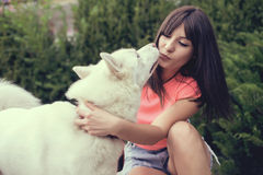 Beautiful girl in the park playing with her Husky dog.  Royalty Free Stock Images