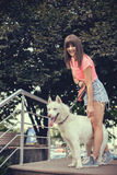 Beautiful girl in the park playing with her Husky dog Royalty Free Stock Photos