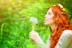 Beautiful girl in a park Royalty Free Stock Images