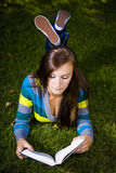 Beautiful Girl in the Park Reading a Book Stock Images