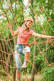 Beautiful girl in the park on the ropes achieve Outdoors royalty free stock photos