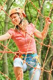 Beautiful girl in the park on the ropes achieve Outdoors stock images