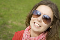 Beautiful girl in a park smiling. Stock Photography
