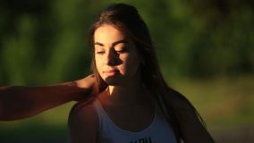 Beautiful girl in park. Summer time sunset stock footage