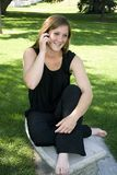 Beautiful Girl in the Park Talking on the Phone Royalty Free Stock Photo
