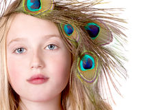 Beautiful Girl with Peacock Feather head dress Royalty Free Stock Image