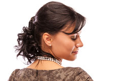 Beautiful girl with pearl beads looks downwards Royalty Free Stock Image