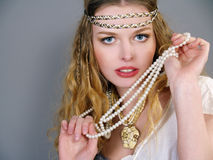 Beautiful girl with pearls beads Stock Photo