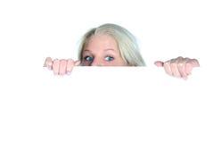 Beautiful girl peeking. On the white background Royalty Free Stock Photography