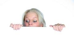 Beautiful girl peeking. On the white background Royalty Free Stock Photos