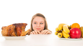 Beautiful girl peeking over the cooked chicken Stock Image