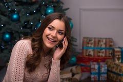 Beautiful girl pending Christmas Stock Photo