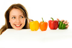 Beautiful girl with peppers Stock Images