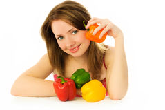 Beautiful girl with peppers Royalty Free Stock Photos
