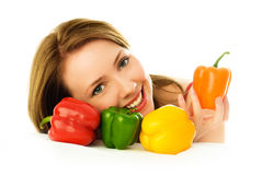 Beautiful girl with peppers Royalty Free Stock Photography
