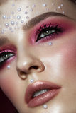 Beautiful girl with perfect art makeup and pearl beads. beauty face. Royalty Free Stock Photography