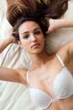 Beautiful girl with perfect body lying on white background Royalty Free Stock Images