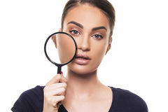 Beautiful girl with perfect face skin concept with magnifier Stock Image