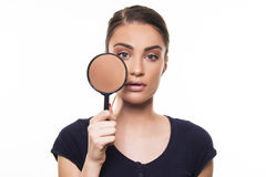 Beautiful girl with perfect face skin concept with magnifier Royalty Free Stock Image