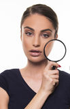 Beautiful girl with perfect face skin concept with magnifier Royalty Free Stock Photos