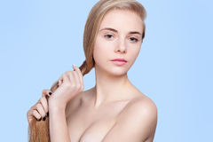 Beautiful girl with perfect long shiny blond hair Stock Photo