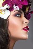 Beautiful girl with perfect skin and bright floral wreath on her head. Stock Photography