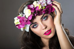 Beautiful girl with perfect skin and bright floral wreath on her head. Royalty Free Stock Images