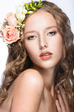 Beautiful girl with perfect skin and bright floral wreath on her head. Royalty Free Stock Photography