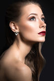 Beautiful girl with perfect skin, dark lips and curls. Beauty face. Royalty Free Stock Photography