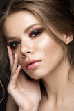 Beautiful girl with perfect skin, evening make-up, wedding hairstyle. Beauty face. Beautiful girl with perfect skin, evening make-up, wedding hairstyle.Beauty Royalty Free Stock Photography