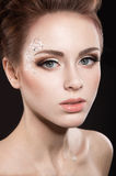 Beautiful girl with perfect skin and evening makeup. Royalty Free Stock Images