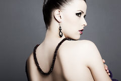 Beautiful girl with perfect skin with jewelry Stock Photography