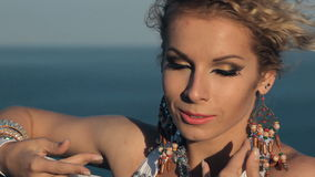 Beautiful girl perform belly dance on the rock in stock footage