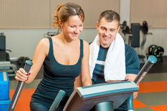 Beautiful girl and personal trainer Stock Photo