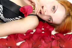 Beautiful girl in petals with rose Royalty Free Stock Image