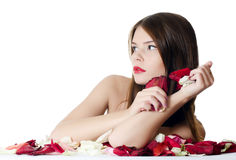 The beautiful girl with petals of roses isolated Stock Photo