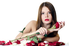 The beautiful girl with petals of roses isolated Royalty Free Stock Images