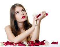 The beautiful girl with petals of roses isolated Royalty Free Stock Photography