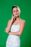 Beautiful girl on the phone. Young woman speaking on a mobile phone smiling on green background Stock Photography